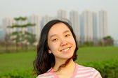Portrait of young Asian woman outdoors — Stockfoto