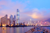 Hong Kong harbour with moving ships at dusk — Stock Photo