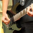 Stock Photo: Playing guitar