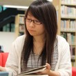 Asian girl student in library — Stock Photo