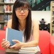 Stock Photo: Asian girl student in library