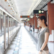 Asian woman waiting for train — Stock Photo