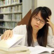 Asigirl student in library — Stock Photo #6289550