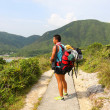 Stock Photo: Asian man hiking at summer time