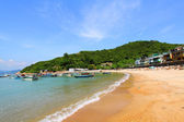 Beach in Hong Kong with many boats and houses — Stok fotoğraf