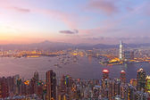 Hong Kong and office buildings at sunset time — Stock Photo