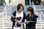 Asian students on campus in a university — Stock Photo