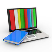 Books into the screen of laptop. — Stockfoto