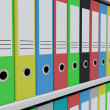Row of colorful archive folders on shelves — Stock Photo #6672134