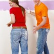 Young couple paint on renovation — Stock Photo