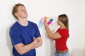 Young couple looking out the wall color — Stock Photo