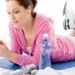 Fitness woman listen music mp3 relax gym - Stock Photo