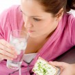 Fitness woman relax glass water snack sportive - Stock Photo