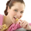 Fitness woman eat granola sportive outfit — Stock Photo #5555845