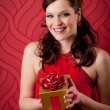 Cocktail party woman hold present evening dress — Stock Photo