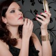Cocktail party woman evening dress apply lipstick — Stock Photo