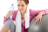 Fitness woman relax water bottle ball sportive — Stock Photo