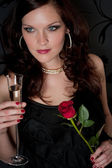 Cocktail party woman evening dress champagne rose — Stock Photo