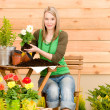 Gardening woman planting spring flower — Stock Photo #5572778