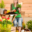 Stock Photo: Gardening woman planting spring flower