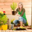 Gardening woman planting on terrace — Stock Photo #5572789