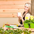 Garden woman terrace enjoy cup coffee spring — Stock Photo #5572851