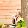 Garden woman terrace enjoy cup coffee spring — Stock Photo