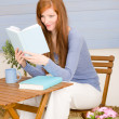 Summer terrace redhead woman read book — Zdjęcie stockowe