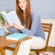 Summer terrace redhead woman relax with book — Stock Photo