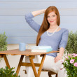 Summer terrace redhead woman relax in garden — Stock Photo #5572913