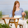 Summer terrace redhead woman relax in garden — Stock Photo #5572914