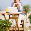 Summer terrace redhead woman with laptop — Stock Photo #5572922