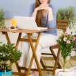 Summer terrace redhead woman with laptop — Stock Photo #5572931