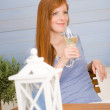 Stock Photo: Summer terrace redhead woman hold glass of wine