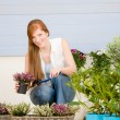 Summer garden terrace redhead woman hold flower — Stock Photo #5572959