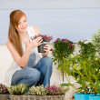 Summer garden terrace redhead woman hold flower — Stock Photo #5572960
