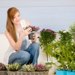 Stock Photo: Summer garden terrace redhead woman hold flower