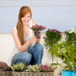 Summer garden terrace redhead woman hold flower — Stock Photo #5572962