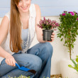 Summer garden terrace redhead woman hold flower — Stock Photo #5572963