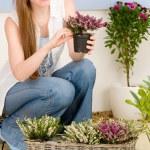 Summer garden terrace redhead woman hold flower — Stock Photo #5572964