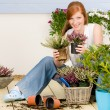 Summer garden terrace redhead woman hold flower — Stock Photo