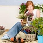 Summer garden terrace redhead woman hold flower — Stock Photo
