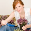 Stock Photo: Summer garden terrace redhead woman potted flower