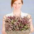 Royalty-Free Stock Photo: Summer redhead woman hold basket with flowers
