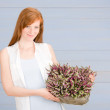 Summer redhead woman hold basket with flowers — Stock Photo