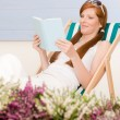 Royalty-Free Stock Photo: Summer terrace red hair woman relax in deckchair