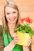 Portrait happy woman hold potted flower spring — Stock Photo