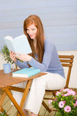 Summer terrace redhead woman read book — Stock Photo