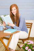 Summer terrace redhead woman relax with book — Stock fotografie
