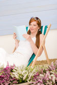 Summer terrace red hair woman relax in deckchair — Stock Photo